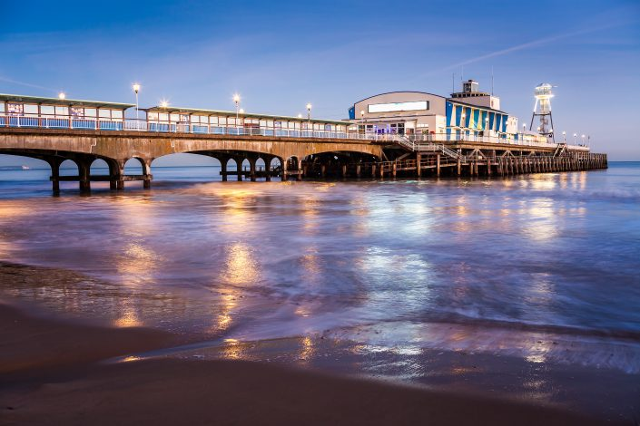 The lights of Bournemouth Pier at night in Dorset